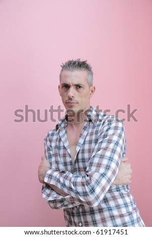 man in checkered shirt keeps your arms folded - stock photo