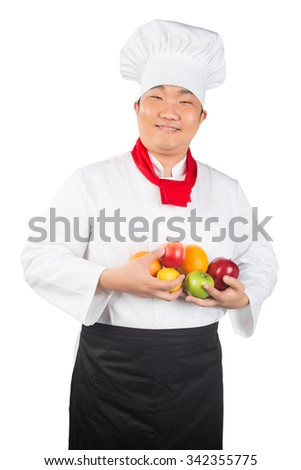 man in chef's hat with fruits on a white background - stock photo