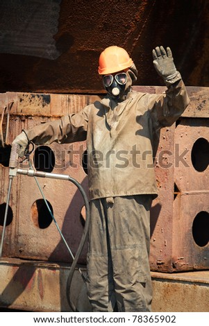 Man in chemical protection suit waving hand - stock photo