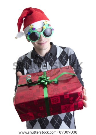 Man in Christmas party glasses and hat holds red gift box