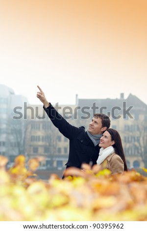 Man in city pointing up with his index finger - stock photo