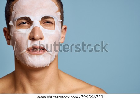 man in cosmetic mask portrait
