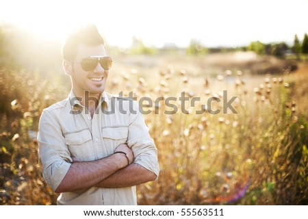 Man in country in summer day - stock photo