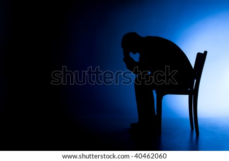Man in depression and despair - stock photo