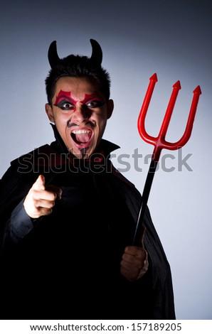 Man in devil costume in halloween concept - stock photo
