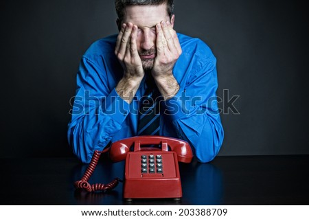 Man in distress about phone call - stock photo