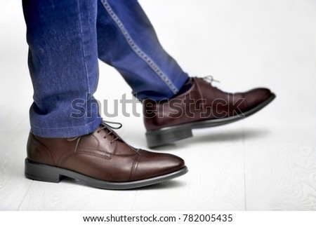 Man in elegant leather shoes indoors, closeup