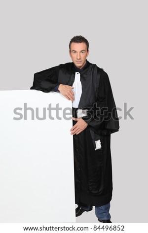 Man in fancy dress holding message board - stock photo