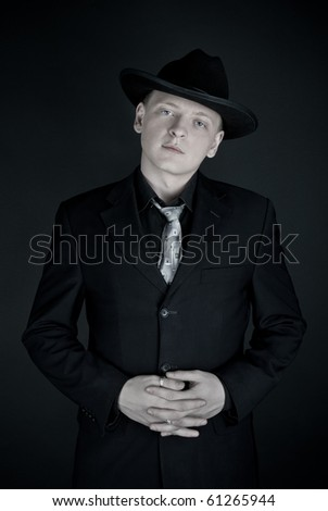 Man in fedora looking to the camera - stock photo