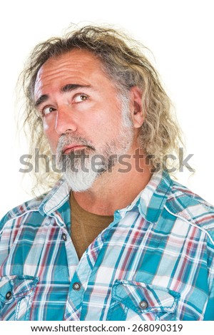 Man in flannel shirt looking over with curious expression - stock photo