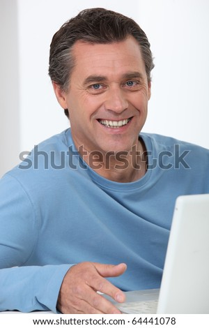 Man in front of a laptop computer - stock photo
