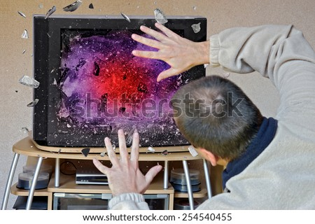 man in front of a television screen exploding - stock photo