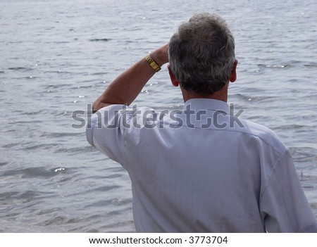 man in front of Lake - stock photo