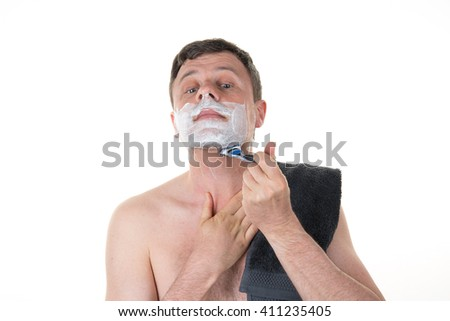 Man in front of mirror shaving in the morning