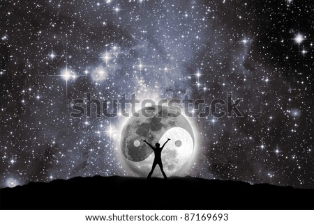 Man in front of moon with the sign of the yin and yang - stock photo