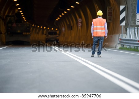 man in front of tunnel - stock photo