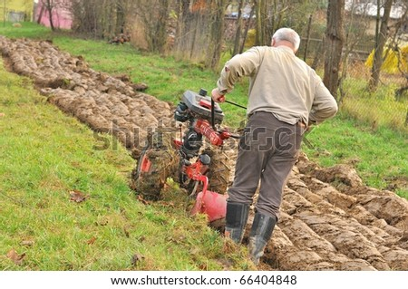 man in garden with tractor