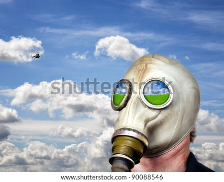 Man in gas mask against blue sky