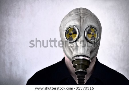 Man in gas mask, photo in grunge style, nuclear warning - stock photo
