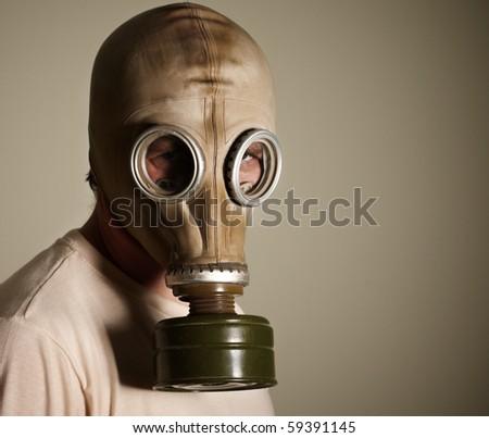 man in gasmask - stock photo
