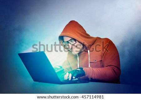 Man in glasses and laptop. Effect of the glow of the screen