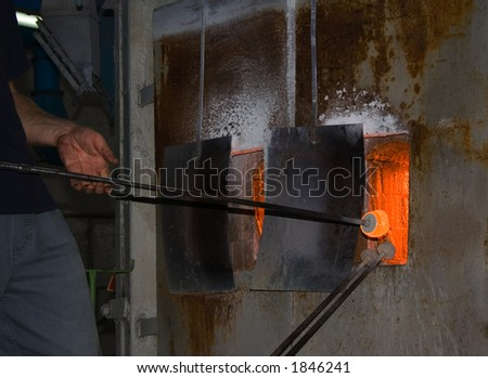 man in glasses hot furnace - stock photo