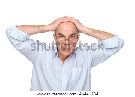 man in glasses to hold on to his head on a white background - stock photo