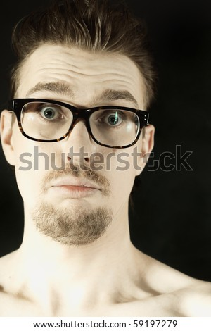 man in glasses with funny face closeup
