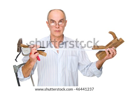 man in glasses with tools in his hands. Isolated on white background - stock photo