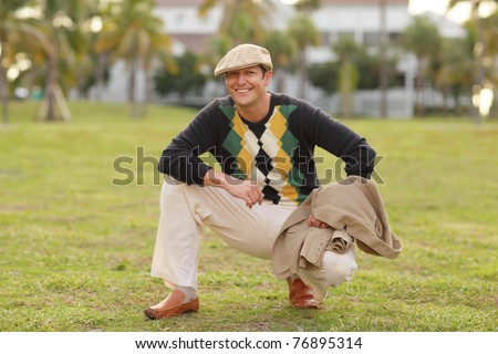 Man in golfing attire - stock photo