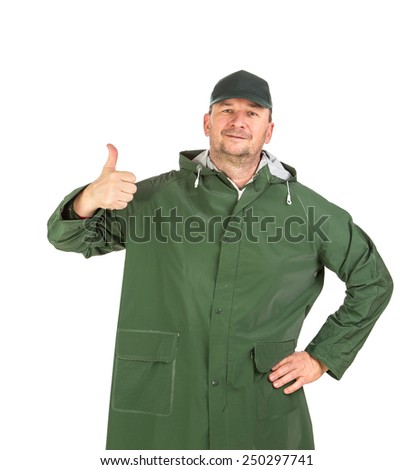 Man in green jacket with thumbs up sign. Isolated on white background