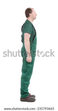 Man in green overalls. Isolated on a white background. - stock photo