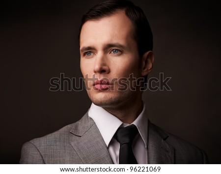 Man in grey suit portarit. - stock photo