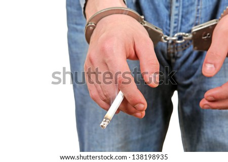 Man in Handcuffs with Cigarette Closeup Isolated on the White Background