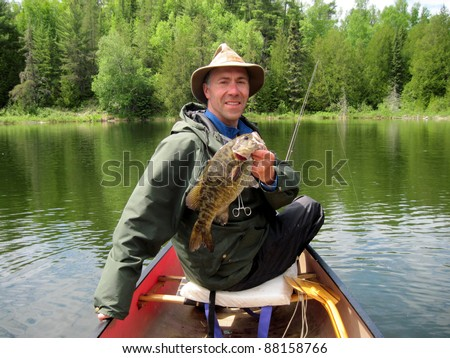 man in hat fishing - stock photo