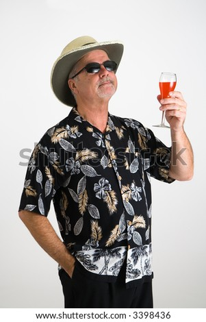 Man in hawaiian shirt making a toast