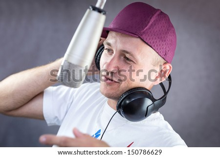 Man in headphones singing in the studio