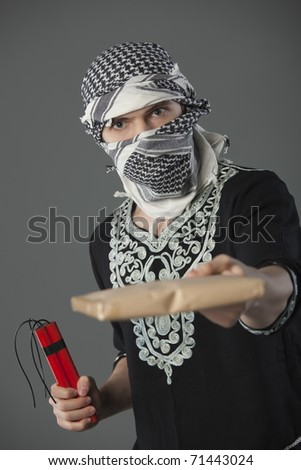 man in headscarf holding letter and dynamite - stock photo