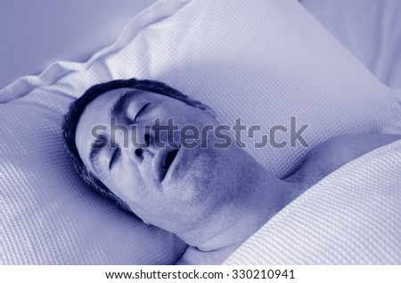 Man in his forties (40s) snoring in bed. Health care concept (BW) - stock photo