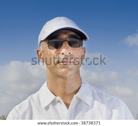 man in his 40's with a white hat
