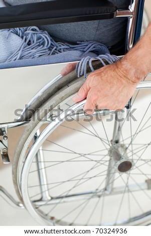 Man in his wheelchair at home - stock photo