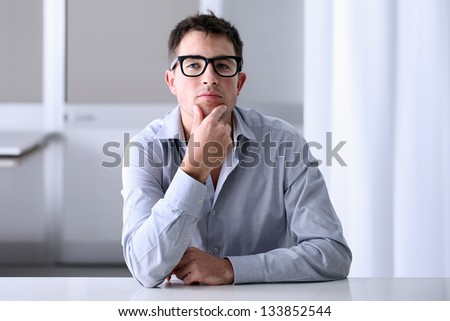 Man in home office with thoughtful look