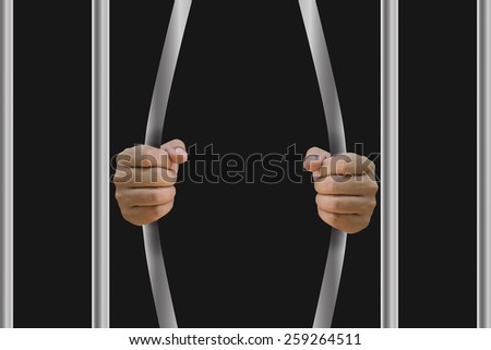 Man in jail hands close-up, depression and despair concept. - stock photo