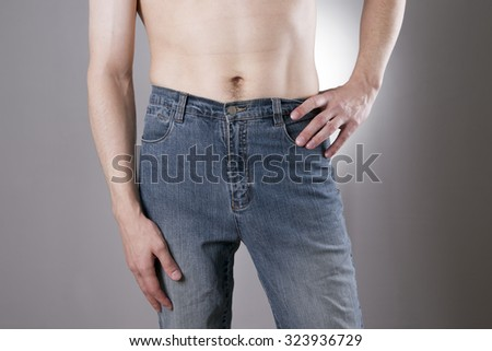 Man in jeans on a gray background