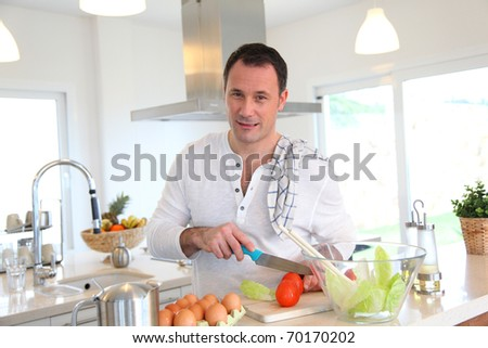 Man in kitchen preparing lunch - stock photo