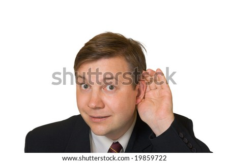 Man in listening pose isolated on white background - stock photo