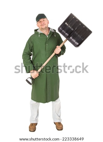 Man in long vest with shovel. Isolated on a white background.  - stock photo