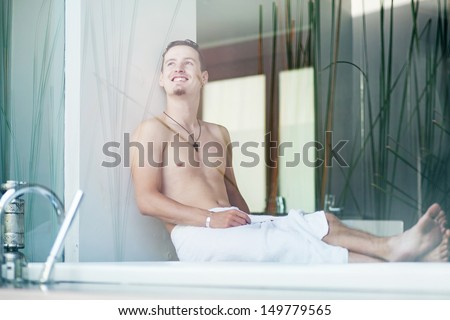 man in luxury bathroom - stock photo