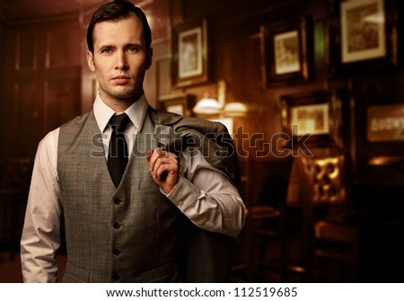 Man in  luxury vintage interior - stock photo