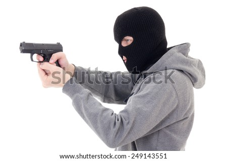 man in mask shooting with gun isolated on white background - stock photo